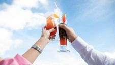 Free Low Angle View Of Couple Holding Glass Of Juice Against Sky Stock Photo - 95477040