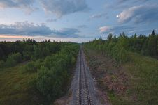 Free Railroad In Between Forest Under Cloudy Sky Stock Photo - 95477060