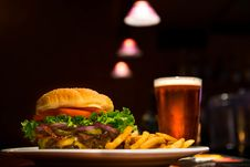 Free Cheeseburger Fries And Pint Of Beer Stock Photos - 95477343