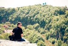 Sitting Alone At The Top Of The Precipice Stock Photography