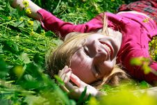 Free Happy Girl Laying In Green Grass Stock Photography - 9553052