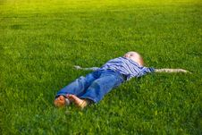 Free Boy Lies On A Grass Royalty Free Stock Image - 9558216