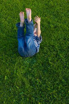 Boy Lies On A Grass Royalty Free Stock Photo