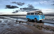 Free Campervan Driving Along Beach Stock Image - 95536841