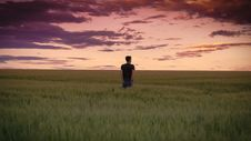 Free Man In Black Shirt Standing On Green Field Grass Royalty Free Stock Photo - 95593635