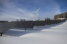 Free Solar Panels And Wind Turbine In Snow Royalty Free Stock Photography - 95593707
