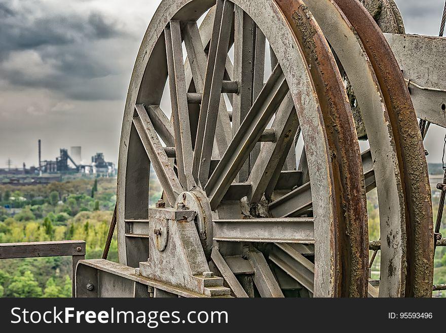 Rusty machinery wheel outdoors