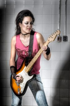 Free Female Playing Electric Guitar Stock Photos - 9561143