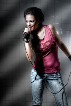 Free Female Singing Rock Music Stock Photography - 9561582