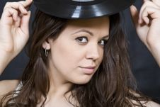 Free Expression Disco Brunette Girl With Vinyl Royalty Free Stock Image - 9565356