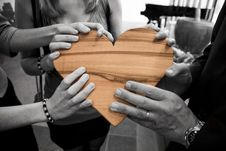 Free Hands Holding Wooden Heart Stock Images - 95643934