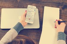 Free Hands Holding Cellphone And Pen On Desk Stock Images - 95643964