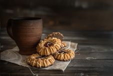 Free Cookies And Mug On Table Stock Photography - 95644002