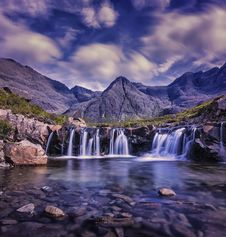 Free Waterfalls With Brown Mountain Range On Background Stock Photos - 95644103