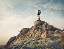 Free Climber On A Mountain Peak Royalty Free Stock Image - 95644316