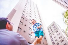 Free Father Balancing Baby Son On One Hand Stock Photos - 95697733