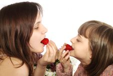 Free Two Little Girls Eating A Strawberries Stock Image - 9572641