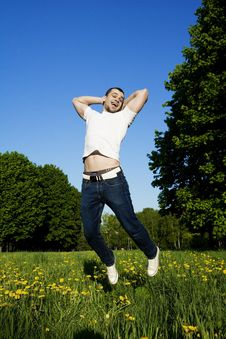 Free The Young Man Smiling Stretches To The Sky Royalty Free Stock Image - 9573146