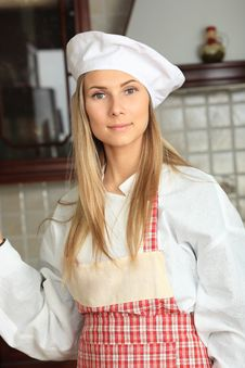 Free Woman On A Kitchen Stock Photos - 9573453