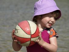 Little Girl Playing Ball. Stock Images