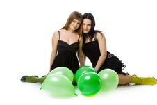 Two Young Girls With Green Ballons Royalty Free Stock Photos