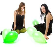 Two Young Girls With Green Ballons Stock Photography