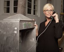 Free Woman On A Payphone Stock Photography - 9577982