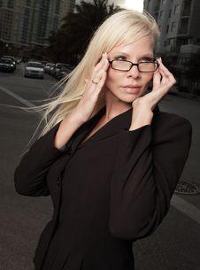Free Businesswoman Adjusting Her Glasses Stock Image - 9578011