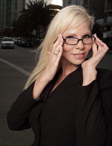 Free Businesswoman Adjusting Her Glasses Stock Photos - 9578023