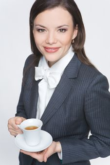 Free The Woman In A Business Suit Holds A Cup Stock Images - 9579094