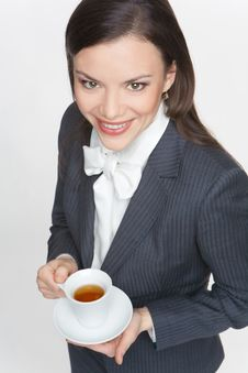 Free The Woman In A Business Suit Holds A Cup Royalty Free Stock Image - 9579106