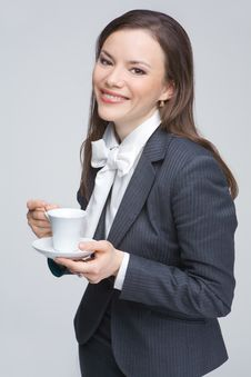 Free The Woman In A Business Suit Holds A Cup Royalty Free Stock Photography - 9579107