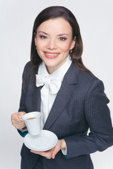 Free The Woman In A Business Suit Holds A Cup Stock Photo - 9579110
