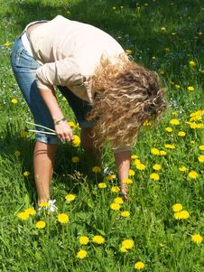 Curly Girl Picking Flowers