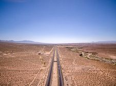Free Aerial Over Highway Through Desert Royalty Free Stock Image - 95798506
