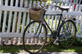 Free Old Rusty Bike Leaned To The White Fence Royalty Free Stock Image - 9587356