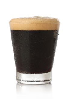 Cold Glass Of Beer Over White Royalty Free Stock Image