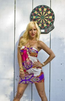 Free Blonde Woman With A Dart Board Stock Image - 9587291