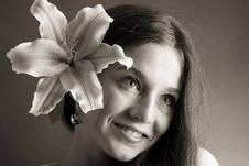 Free Young Woman Posing With A Lily Royalty Free Stock Image - 9589916