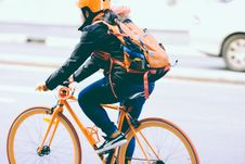 Free Man In Jacket Riding Bicycle Stock Images - 95868284