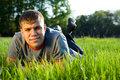 Free Portrait Of Man Lying Down Of Grass. Royalty Free Stock Photography - 9597837