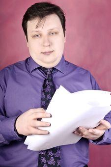 Free Businessman Reading Documents Royalty Free Stock Image - 9595856