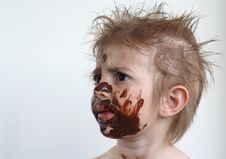 Free Child Eating Chocolate Royalty Free Stock Photography - 9596797