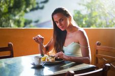 Free Portrait Of Woman Eating At Table Stock Images - 95931704