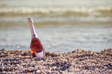 Free Sparkling Wine Bottle On Beach Royalty Free Stock Photo - 95931715