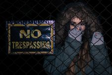 Free Woman Next To No Trespassing Sign Royalty Free Stock Image - 95931776
