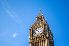 Free Low Angle View Of Clock Tower Against Blue Sky Stock Photo - 95931850