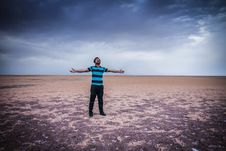 Free Man Standing In Desert With Open Arms Stock Image - 95996941
