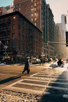 Free Person Crossing Road In City Royalty Free Stock Image - 95997036