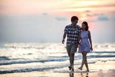 Free Couple Strolling On Beach At Sunset Royalty Free Stock Photo - 95997165